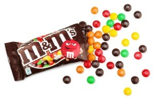 bag of M&Ms with scattered candies