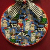Embroidery Hoop Pet Art - Christmas pet fabric in hoop with a ribbon