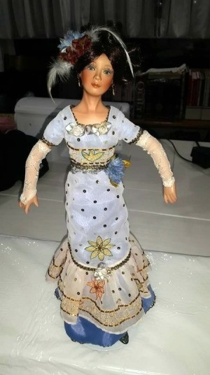 Identifying a Porcelain Doll Maker - doll wearing a long narrow blue dress and fingerless long lace gloves