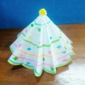 Paper Christmas Tree - paper tree on a wooden surface
