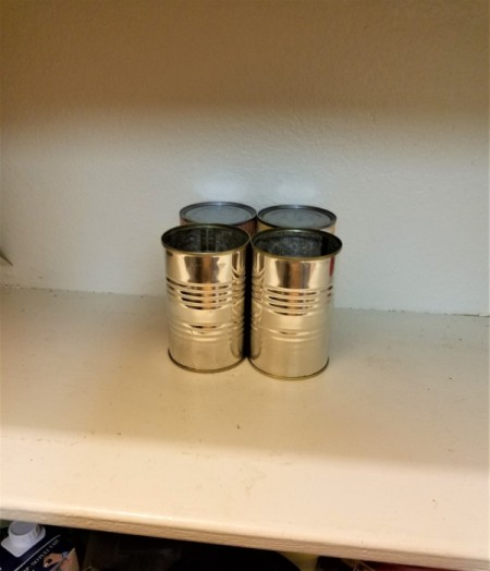 four recycled cans to use as support for the shadowbox frame.