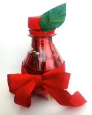 Apple-Bottle Christmas Gift Container - filled apple bottle on white background