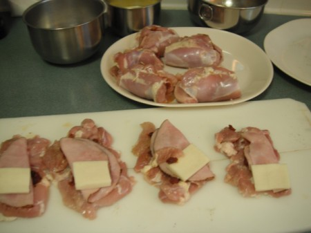 cheese and ham on chicken pieces