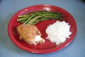 Mozzarella and Ham Chicken Thigh on dinner plates