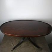 Value of an Oval Mersman Coffee Table - mahogany coffee table