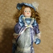 Value of a Limited Edition J. Misa Porcelain Doll - doll in blue satin dress with a matching hat