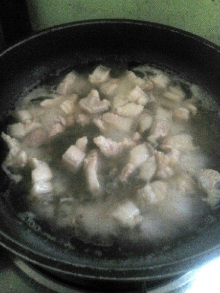 simmering pork pieces
