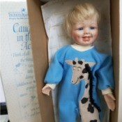 Value of  an Ashton Drake Galleries Doll - doll in giraffe one piece PJ set