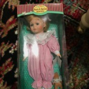 Value of a Hearts and Harvest Memories Doll  - doll in pink and white jumpsuit in a box