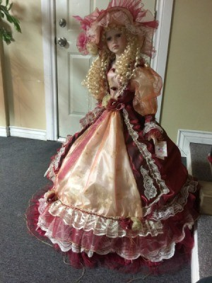 Value of a J. Misa Collection Doll - doll wearing a fancy pink and burgundy lace trimmed dress