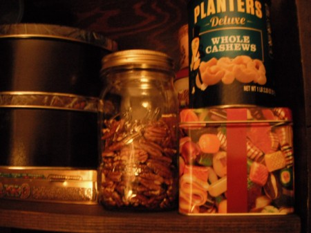 Roasted Pecans in jar with other food tins