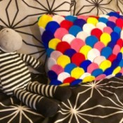Dragon Scale Pillow - colorful pillow on black and white bed set