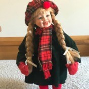 Identifying a Porcelain Doll - doll wearing a plaid hat and scarf