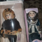 Value of a Collectible Memories Porcelain Doll - two dolls in boxes
