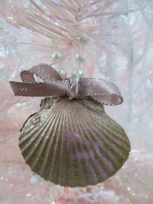 Shabby Chic Shell Ornaments - closeup of ornament with a tiny bow handing in a pink and white tree