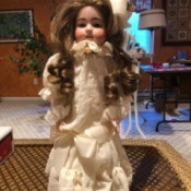 Porcelain Doll Identification and Value - doll in ivory period dress