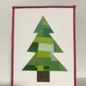 Recycled Christmas Card - finished card on shelf against white background