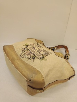 Restoring the Design on a Coach Purse - purse with worn design