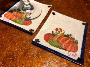 Personalized Decoupaged Napkin Coasters - two coasters, one with a stemmed glass base visible