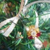 Use Costume Jewelry as Mini Ornaments - closeup of an angel pin ornament