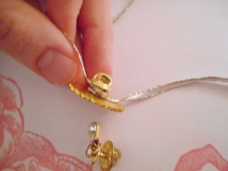 Use Costume Jewelry as Mini Ornaments - adding ribbon to needle clip back style pin