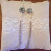 Broken Chain Earrings - new earrings from old chain and beads on a small white lace pillow