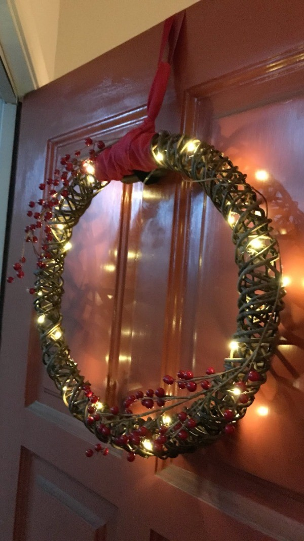 A wreath hanging from a ribbon.