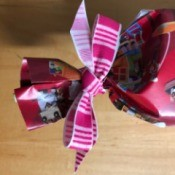 Using Toy Catalog Pages as Gift Wrap - trim ribbon ends