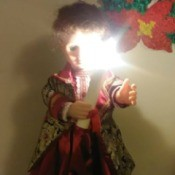 Identifying a Porcelain Doll - doll in long red dress holding a candle
