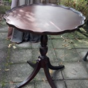Value of a Brandt Mahogany Pie Crust Table - four legged pedestal pie crust table