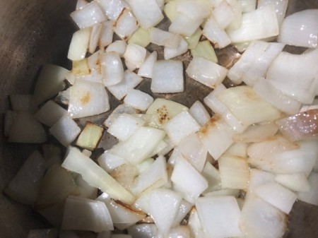 sauteing chopped onions in pan