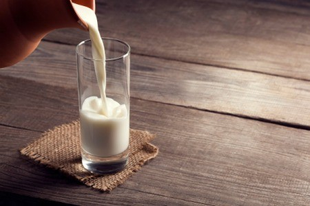 Pouring a glass of milk.