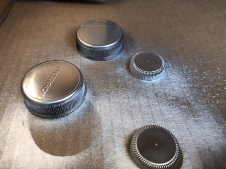 Plastic Bottle Cap Ornaments - spray paint the outside of the caps and allow to dry