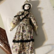 Identifying a Porcelain Doll - old style porcelain doll in print dress