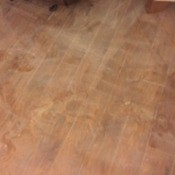 Leak Left White Powder Residue on Laminate Floor