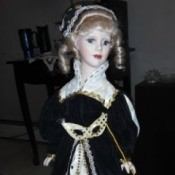 Identifying a Porcelain Doll - doll in elegant black and white gown with matching hat