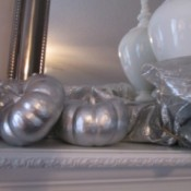 Transforming Gourds Into Elegant Decor - two gourds on a white mantle
