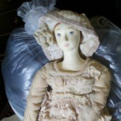 Identifying a Porcelain Doll - old style doll wearing a hat and matching long dress with lace