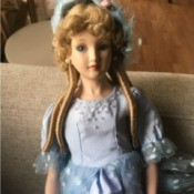 Identifying a Porcelain Doll - doll in blue dress