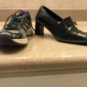 A sneaker next to a heeled dress shoe.