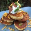 Potato Patties with sour cream cheese & chives on plate