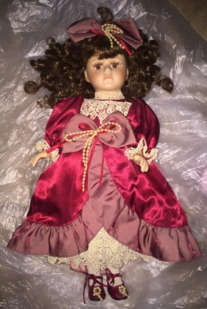 Value of a Collector's Choice Porcelain Doll - doll in satin dress with lace trim