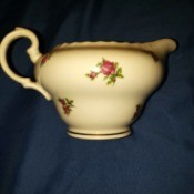 Value of Bohemian China - creamer with a rose pattern