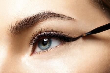 closeup of person applying eyeliner