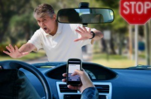 driver texting about to hit pedestrian