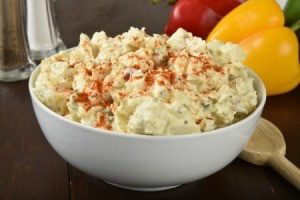 bowl of potato salad sprinkled with paprika