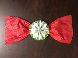Snowflake Bow for Oversize Gift - red tissue paper bow with a paper snowflake in the center mounted to a cupcake liner