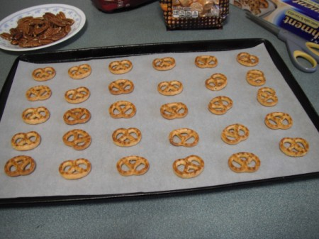 Pretzel on baking tray with parchment paper