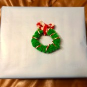 Mini Christmas Wreath - wreath on a wrapped gift