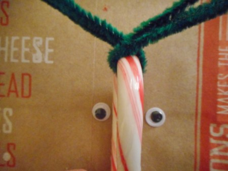 Reindeer Candy Cane - place crook of the cane in the V and cross the pipe cleaners over once
